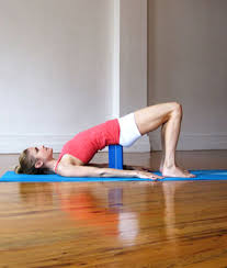 yoga, supported bridge pose